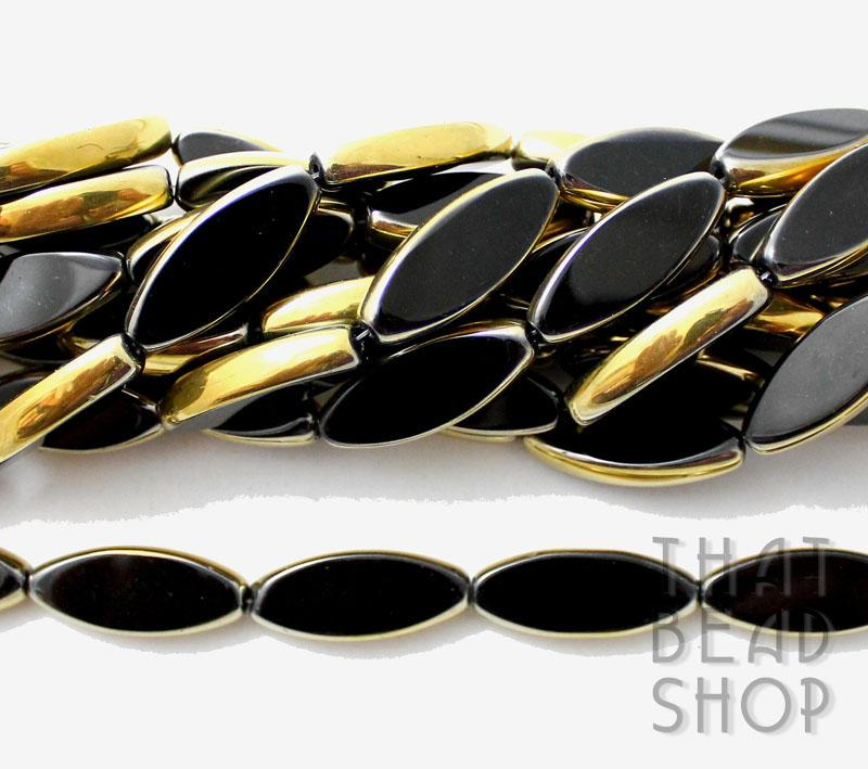 Black with Gold Window Cut Long Oval Glass Beads